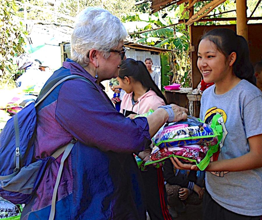 Yvonne Garcia distributing blankets.